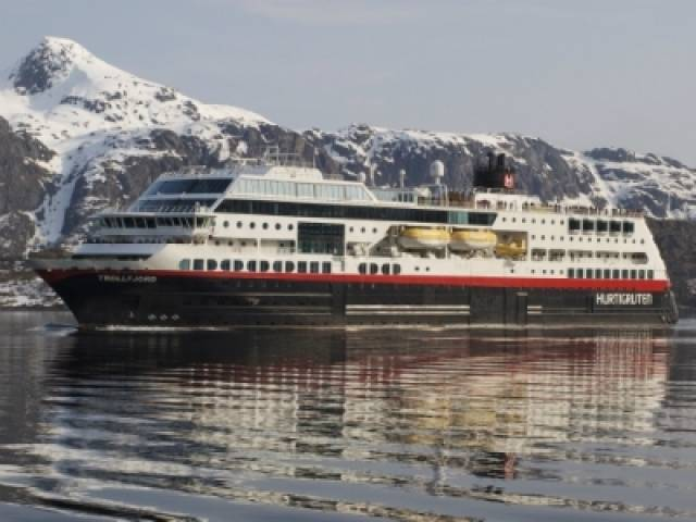 Hurtigruten's 'Milleninnium' class Norwegian coastal voyages cruiseship Trollfjord that can also take cars. The 2002 built vessel made a promotional call to Dun Laoghaire Harbour early in her career.