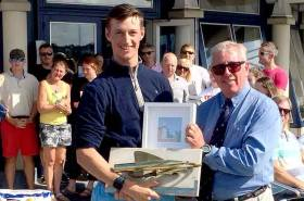 Ewan McMahon (left) winner of the Laser Standard Rig division at the Leinster Championships at Howth Yacht Club from Vice Commodore Ian Byrne
