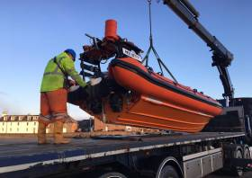 Stonehaven RNLI's Atlantic 75 Miss Betty is lowered onto a trailer for transport to RNLI HQ in Poole