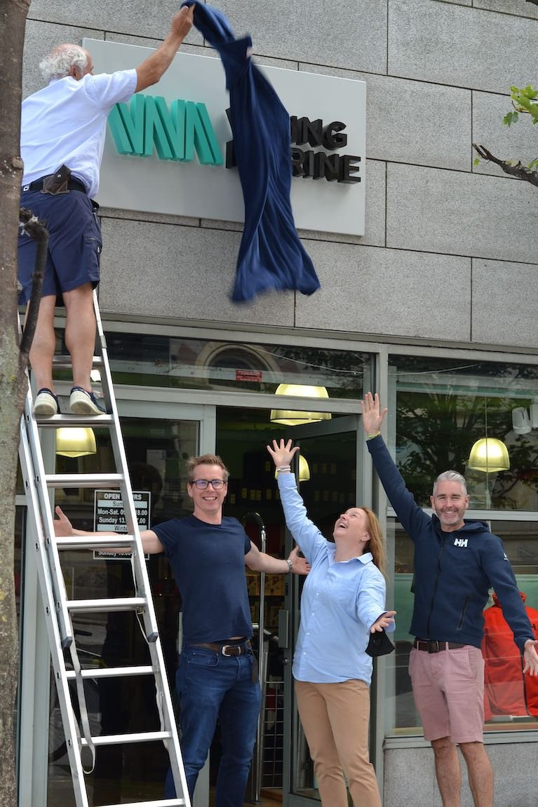Ian O'Meara (on ladder) unveils the new logo at the Viking Marine store at the Pavilion in Dun Laoghaire Harbour with Gerard Whelan, Brand Central Design who created the new brand, Antonia O Rourke Viking Marine, Paddy Kirwan of Helly Hansen