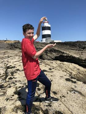 Gar Heffernan holding the winning image of Hook Head (Lighthouse) Co. Wexford, the scene captured the essence of summer fun at our lighthouses.