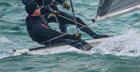 Noel Butler (pictured above) & Marie Barry  in Fireball 15061 lead the fast PY fleet at the DMYC Frostbites