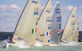 After two false starts and a general recall, Oisin McClelland, from Ireland, rounded the top mark in Race 1 in first place after favouring the middle right
