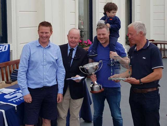 Royal Irish Yacht Club Vice Commodore Pat Shannon (second from left) presents the overall trophy to the winning Bád Kilcullen crew Kieran Dorgan (left) Stefan Hyde and son and Jimmy Dowling