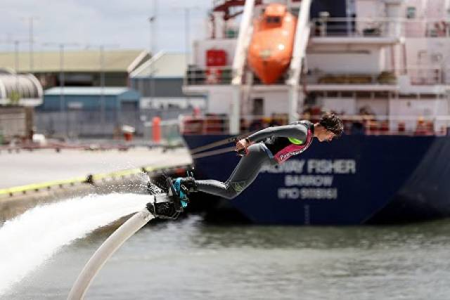 So far thousands have flocked west for first day of SeaFest, which continues this weekend. Above the flyboarding antics of Jet Man!  In the background is the coastal tanker and regular caller to the port, the aptly named  Galway Fisher which had sailed from Whitegate Oil Refinery. See related story under Cork Harbour news dated 27 July.