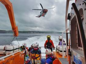 Portrush RNLI assist with the rescue of a man who fell on rocks near Dunluce Castle