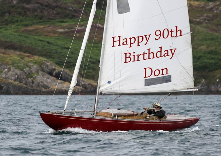 Telling it like it is: Glandore greetings for 90-year-old Don Street on Saturday as he apparently sails vintage Dragon Gypsy single-handed………..