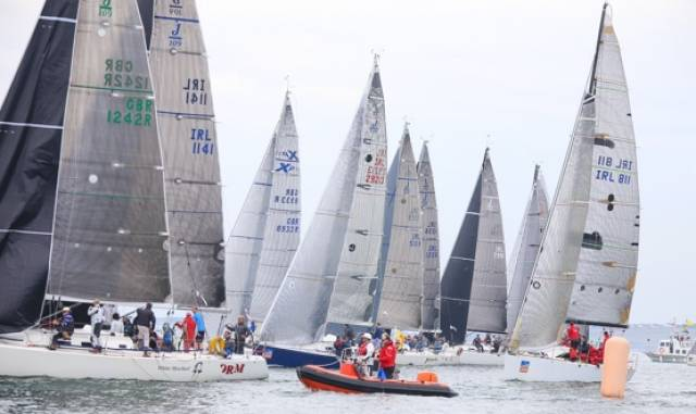 An on–the–water jury keep a close eye on a class one start at today's ICRA National Championships off Howth