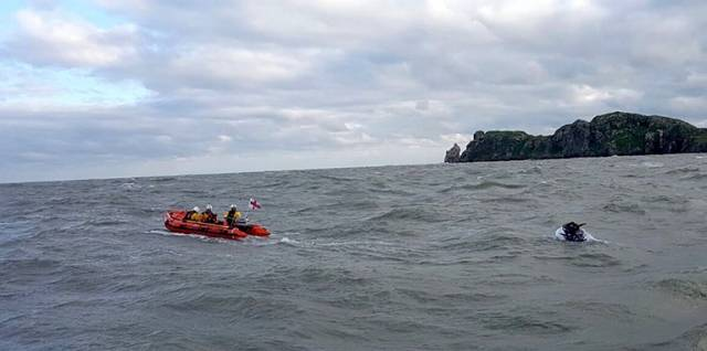 The inshore lifeboat retrieve the stricken Jet-Ski