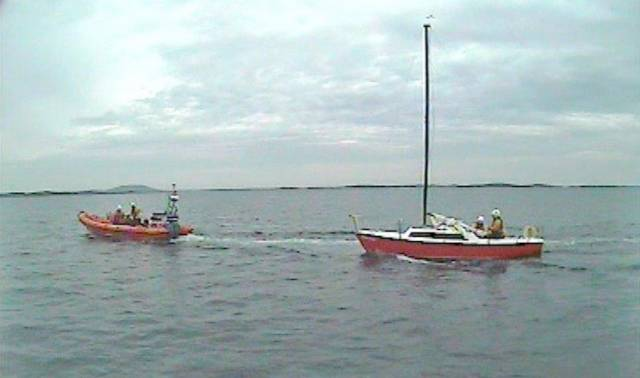 Clifden RNLI's inshore lifeboat taking the solo yacht under tow