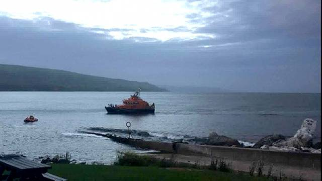 The initial alarm was raised by a member of the public reporting two kayakers in trouble with one kayaker in the water