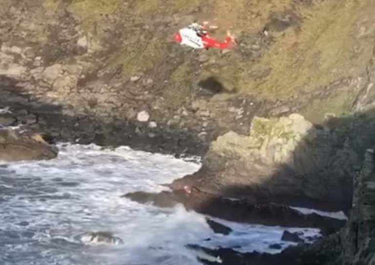 Rescue 117 lowers its winchman amid high winds off the Old Head of Kinsale on Sunday 27 December