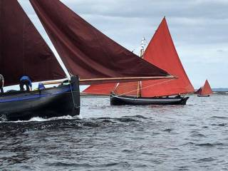 The magic and mysteries of the west – traditional boats of Connemara shaping up for racing at Kinvara on Sunday