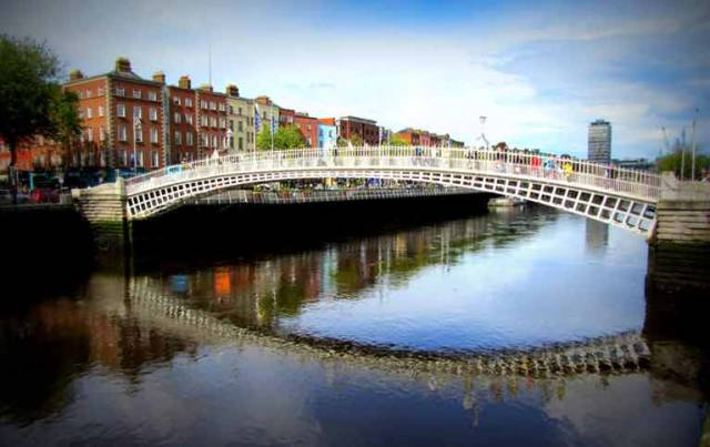 The Hal'penny Bridge over the River Liffey in Dublin