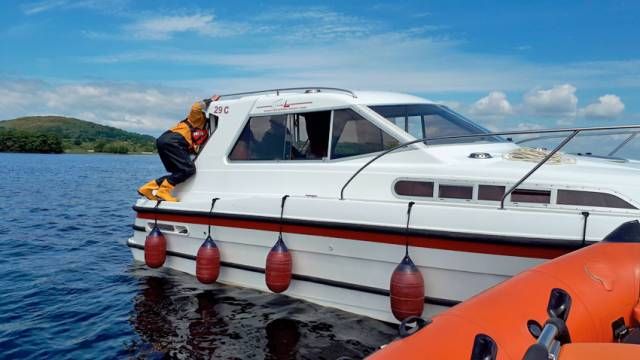 Lough Derg RNLI crew check over the cruiser that ran aground at Tullabeg