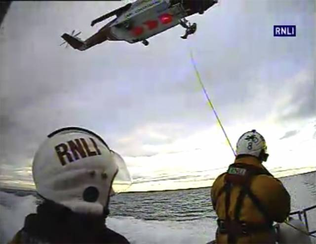 Larne RNLI winching crew from the deck of their all-weather lifeboat to Rescue 999 from Prestwick