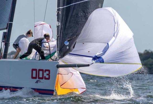 Anthony O'Leary's Royal Cork crew gather the spinnaker on the bow of their IC37 in the penultimate race of the 2019 Rolex New York Yacht Club Invitational Cup