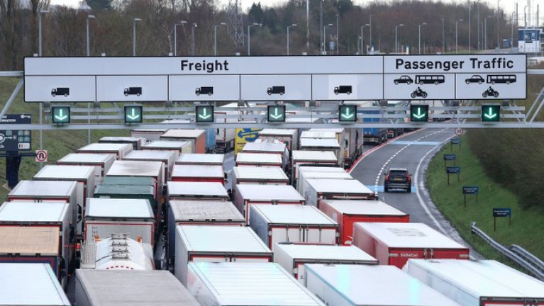 Some Irish truckers stranded in UK will have to look at other routes, says Eamon Ryan. Above file photo dated Dec. 11th of lorries queuing to access the Eurotunnel site near Folkestone in Kent. AFLOAT adds at nearby Port of Dover is closed to all accompanied traffic leaving the UK until further notice. Operation Stack (phase 2) has now been implemented to deal with freight trucks.