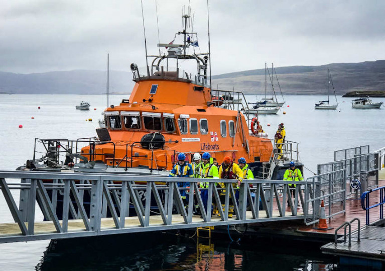 Tobermory RNLI crew and local HM Coastguard volunteers help bring the injured man ashore