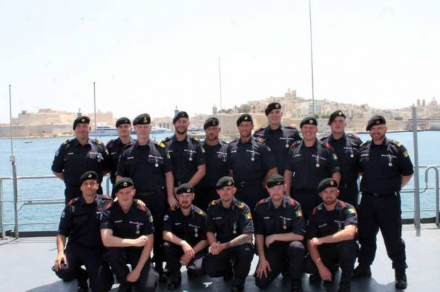 Crew members of L.É. Samuel Beckett (which docked in Valletta, Malta) with their 'Operation Sophia' medals presented in recognition of their role in disrupting human-trafficking and smuggling in the central Mediterranean