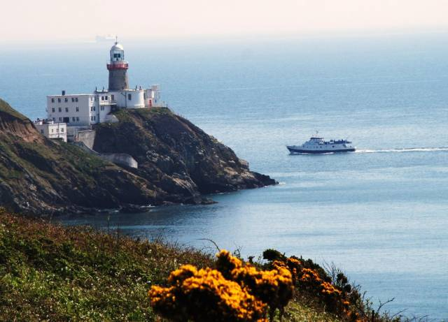 Irish Lights which operates and maintains marine aids to navigation (AtoN's) among them the iconic Baily Lighthouse, Howth Peninsula on Dublin Bay. AFLOAT adds this file photo includes the former fast-ferry HSS Stena Explorer (on hazy horizon left of lantern) during a crossing from Holyhead, Wales and bound for Dun Laoghaire Harbour. In the foreground is Dublin Bay Cruises excursion vessel St. Bridget heading for Howth Harbour.