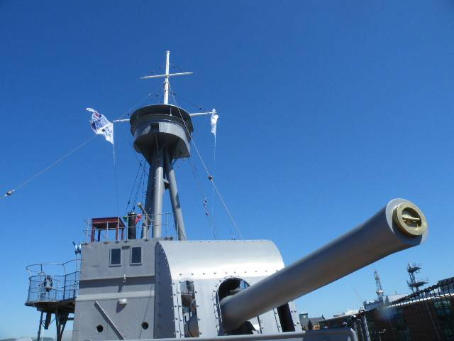 The 6 inch bow-mounted gun of HMS Caroline, the Royal Navy light cruiser which after decommissioning as a static training ship in 2011 opened to the public in Belfast Harbour as a museum on the centenary of the Battle of Jutland in 2016. Afloat adds the light cruiser was built on Merseyside at Cammell Laird, Birkenhead, England.