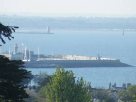 East Pier, Dun Laoghaire Harbour as seen from Dalkey Quarry which was used to begin construction in 1817. Among the events of DLR Spring into Heritage are free guided walking tours of the 200 year old harbour. Beyond are the lighthouses that mark the entrance to Dublin Port.