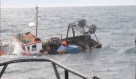 Castletownbere RNLI have rescued two fishermen from this sinking boat on the Beara peninsula