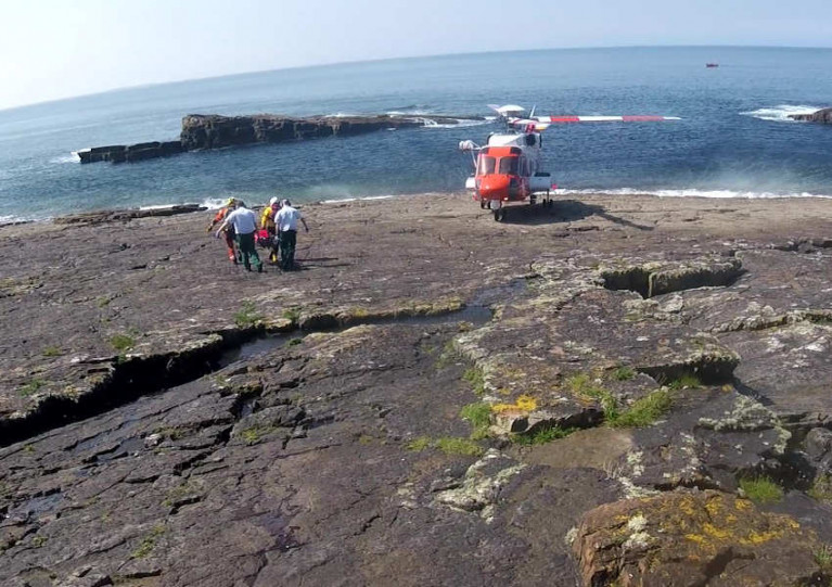 The female casualty is transported to Rescue 118 following a fall at Mullaghmore Head