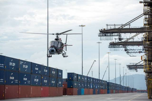 The Next Bond Movie where above a helicopter films one of the action sequences at the container terminal in Kingstown, Jamaica which involved Eon Productions in partnership with French container giant CMA CGM. AFLOAT adds the operator's Irish division, CMA CGM Shipping (Ireland) Ltd has offices located in Dublin and Cork from where 'feeder' vessels serve these ports connecting to Europe and beyond.