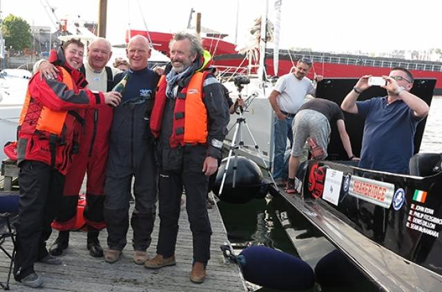 Round Ireland record holder Sean McNamara, Denis Dillon, Philip Fitzgibbon and John Ryan celebrate in Kinsale having set a new record time of 12 hours 54 minutes and 24 seconds