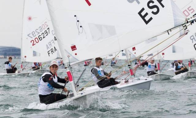 Radial boys approach a turning mark during the World Championships at the Royal St. George Yacht Club