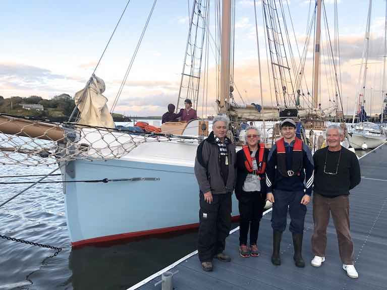 Back at her real home after 93 years – the 56ft 1926-built restored Limerick Trading ketch Ilen takes up her berth in Foynes for the first time in 94 years yesterday (Friday) evening. On the Foynes YC pontoon are (left to right) Ilen Project Manager Gary Mac Mahon, and Conor O'Brien family relatives Rob, Alison and Stephen O'Brien. Conor O'Brien's modest house of Barneen on Foynes Island, in which he designed both Saoirse and Ilen and spent his last days in 1952, is just visible above Ilen's bowsprit.