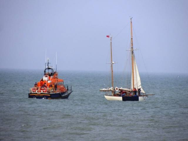 Arklow RNLI's Ger Tigchlearr arrives to assist the stranded vintage vessel on May Day