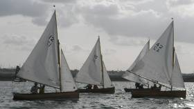 Michael and Jenny Donohoe in Water Wag No.12, Alfa, Paul and Anne Smith in Swallow No.40, and William and Linda Prentice in Tortoise No.42 approaching the start line.