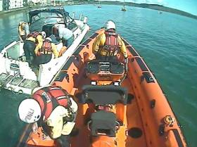 Youghal's lifeboat crew helps pump out water from the vessel moored in Youghal Harbour