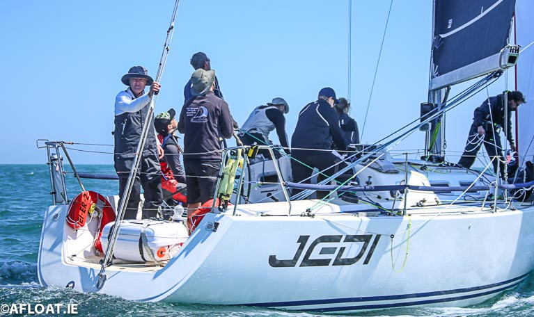 Michael Boyd (facing aft) onboard Jedi at the start of the 2018 race is the lead skipper for the Round Ireland Volvo Car prize