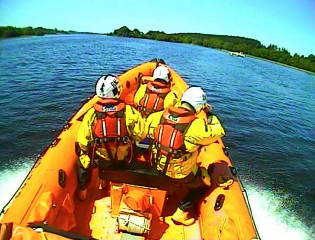 Enniskillen RNLI crew approaching the casualty vessel that had reported a fire on board