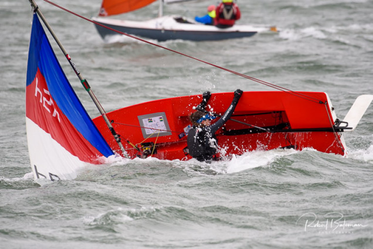 A Topper capsizes in breezy conditions at the Kinsale Yacht Club Spring Series