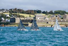 Katherine Hedley leads Adam Billany followed by John Patrick in Race one of the International 2.4mR Open Championships at Kinsale Scroll down for photo gallery