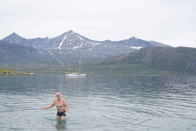 Breanndán Ó Beaglaoich goes swimming in Greenland with Ilen anchored in the Bay at Cape Farewell