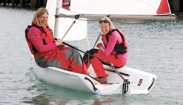 People at every level can get involved with bringing newcomers into the sport. Showing how it's done with a Toppper Topaz at a Try Sailing Women on Water event is former Olympian Cathy MacAleavey (left) with sailing newbie Sarah Byrne
