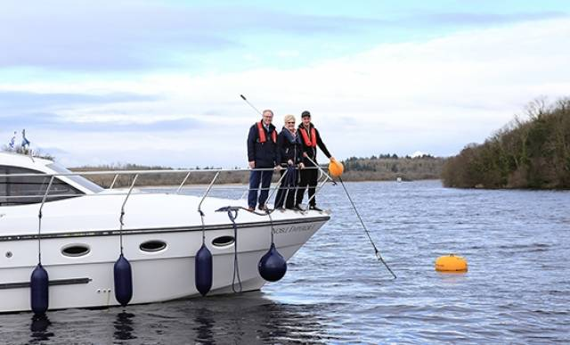 Manor Marine tourists with a WI Director and the new mooring buoys on Lough Erne