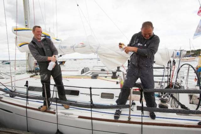 Dubliners Liam Coyne and Brian Flahive on First 36.7 Lula Belle celebrate their victory in Cowes after the 2014 RB&I