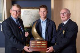 Presentation of Pyewacket Trophy by Rear Admiral Dinghies, Brian Jones (left) to Atlee Kohl (centre) and Admiral Pat Farnan
