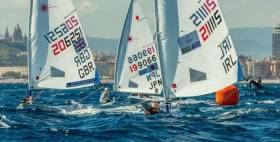 Howth Yacht Club's Aoife Hopkins leads the fleet around the Weather mark in race two of the Laser European Championships in Barcelona