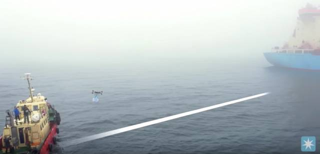 Maersk deliver cookies in a bag slung under a drone to a moored tanker. See full video below.