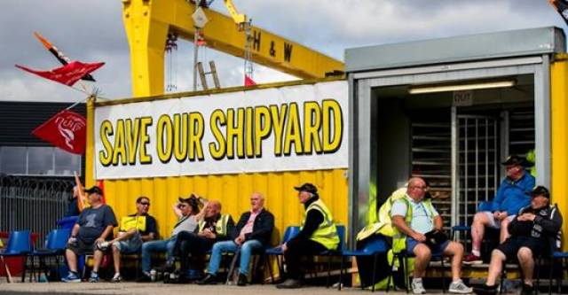 Employees of Harland and Wolff during their protest at the gates of the shipyard in Belfast