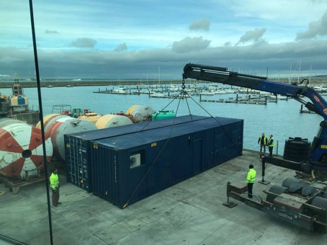 The new containers are moved into position at the Irish Lights Depot