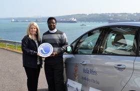 Anna Malloy, Stakeholder Engagement and Communications Manager with Father Paul Osunyikanmi, Apostleship of the Sea Chaplain for the Port of Milford Haven and Pembroke Port.